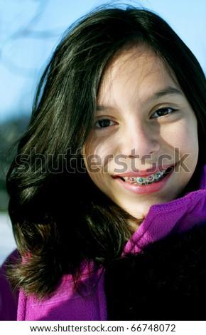 Young smiling girl, enjoying the outdoors