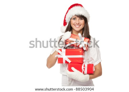 Young smiling girl in Santa hat holding a heap of gift boxes isolated with copy-space over white background