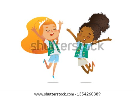 Young smiling girls scout dressed in uniform with badges and patches happily jump isolated on white background. Female scouter, member of troop, speaker