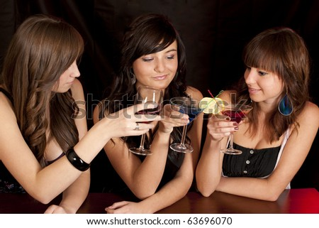 young smiling girls with color coctail