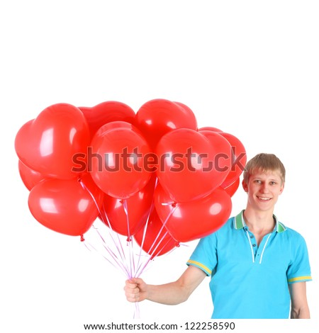 young smiling handsome guy with the heart shape balloons