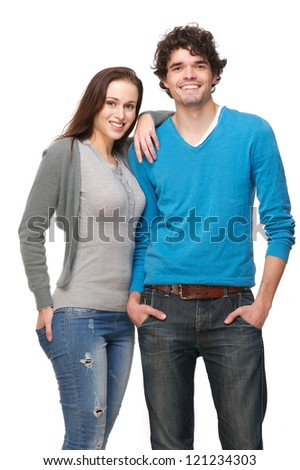 Young smiling happy couple isolated on white background Boyfriend and girlfriend are in a relaxed pose and laughing