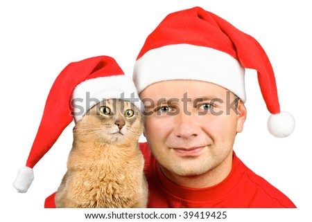 Young smiling man and cat in Santa's hat, isolated on white