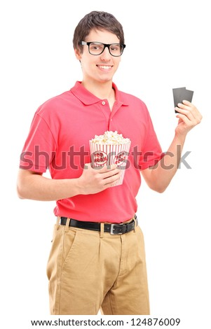 Young smiling man holding a popcorn box and two tickets for cinema isolated on white background