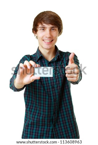 Young smiling man holding blank white card to write it on your own text isolated on white background