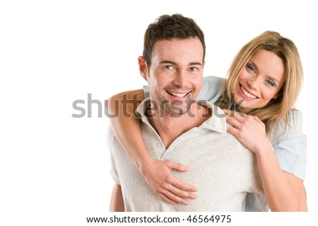 Young smiling man piggyback his beautiful girlfriend isolated on white background with copy space