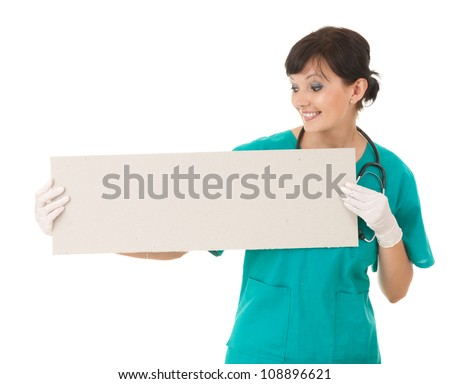 young smiling nurse or doctor showing empty blank sign board, white background