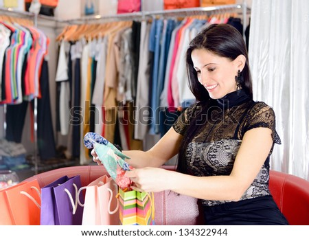 Young smiling pretty brunette shopping in mall