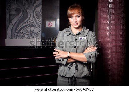 Young smiling receptionist in a hotel