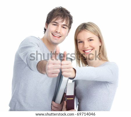 Young smiling  students with books. Over white background - stock photo