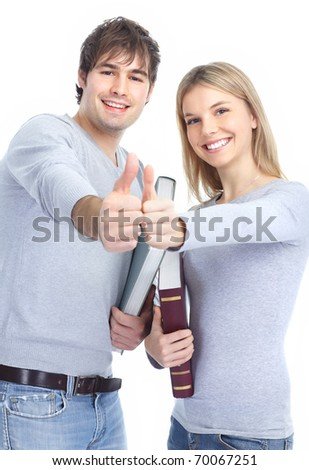 Young smiling  students with books. Over white background