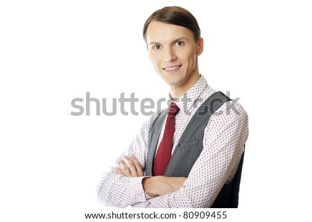 Young smiling teacher or trainer with arms crossed on a white background