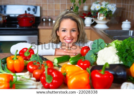 Young smiling woman  cooking in the kitchen