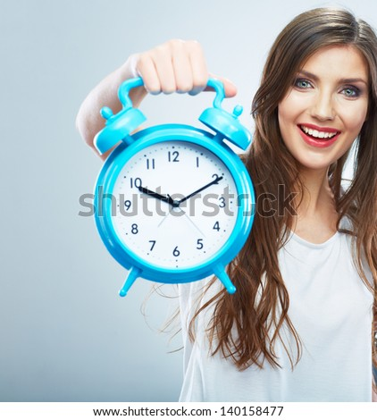 Young smiling woman hold blue watch. Beautiful smiling girl portrait. Isolated studio background female model.