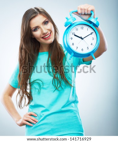 Young smiling woman hold watch. Beautiful smiling girl portrait. Isolated studio background female model.