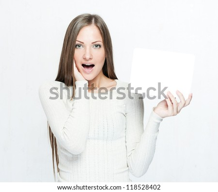 young smiling woman holding blank business card