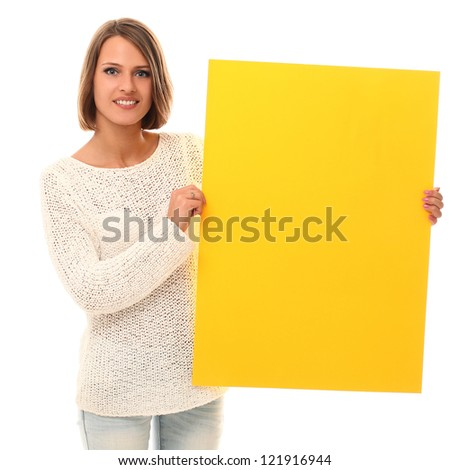 Young smiling woman holding blank paper in a hands