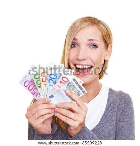Young smiling woman holding fan made of Euro money