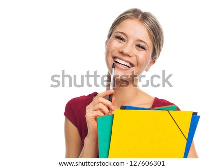 Young smiling woman holding folders, on white