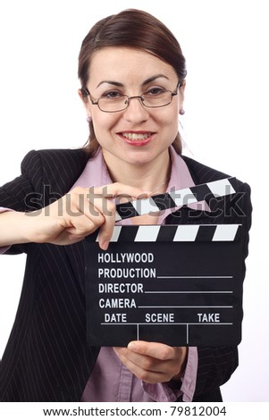 Young smiling woman holding movie clapper