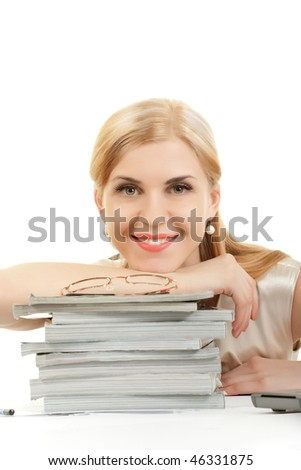 Young smiling woman laying on the pile of magazines