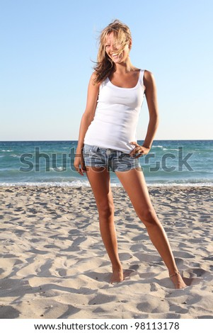 young smiling woman on beach background