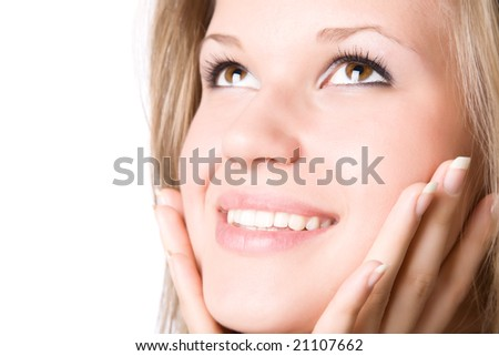 Young smiling woman portrait. Isolated on white.
