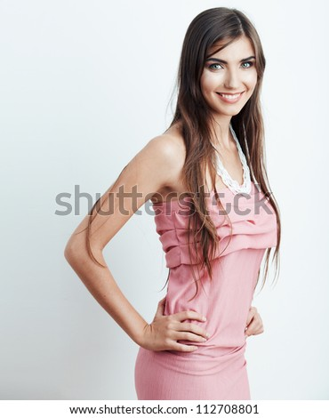 Young smiling woman portrait. Pink dress.
