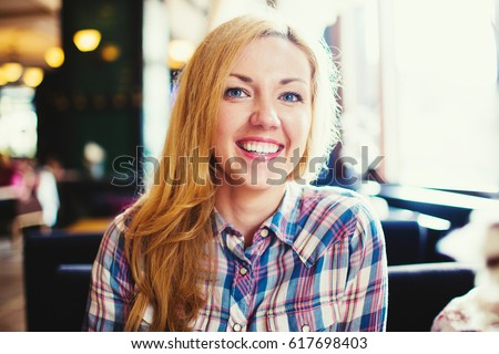 Young smiling woman portrait. Positive woman emotions concept.
