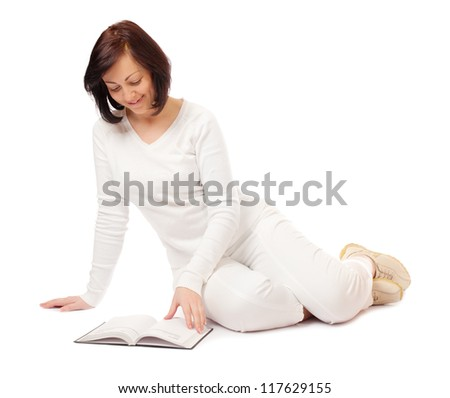 Young smiling woman reading book isolated