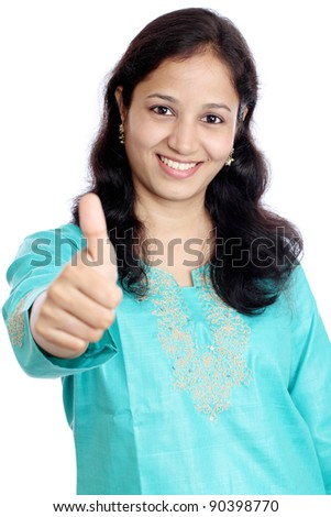 young smiling woman showing thumbs up
