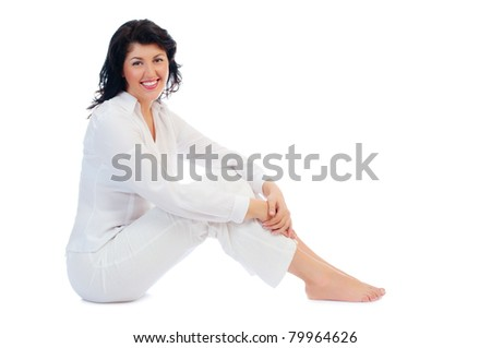 Young smiling woman sitting on floor isolated