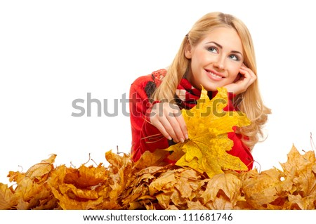 Young smiling woman with autumn leaves