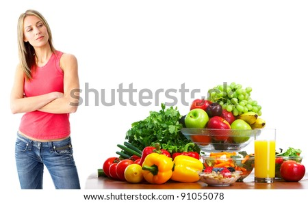 Young smiling woman with fruits and vegetables. Isolated ver white background