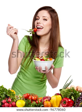 Young smiling woman with fruits and vegetables. Over white background