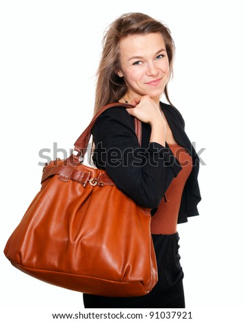 Young smiling woman with handbag isolated on white
