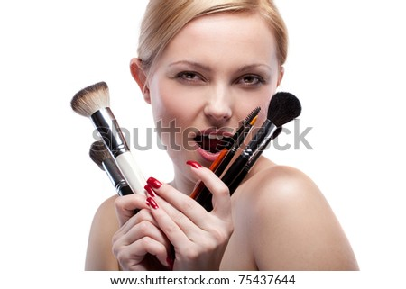Young smiling woman with make up brushes isolated on white