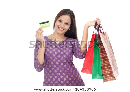 Young smiling woman with shopping bags and credit card