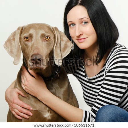 Young smiling women with dog