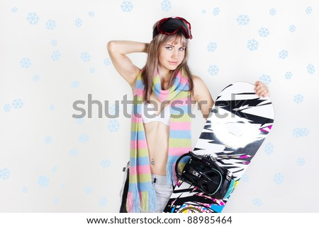 young snowboarder girl in bikini  with snowboard