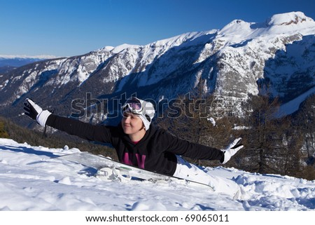 Young snowboarder is having fun on snowboard