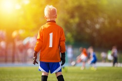 Young Soccer Goalie Goalkeeper. Young Boy Soccer Goalie. Soccer Game on Sunny Summer Day. Sport activities for children.. Football Match in the Backround. Youth Sport Wallpaper.