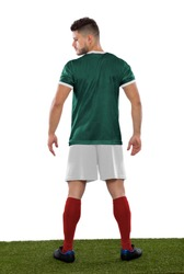 Young soccer player back on grass with mexico green shirt  on white background