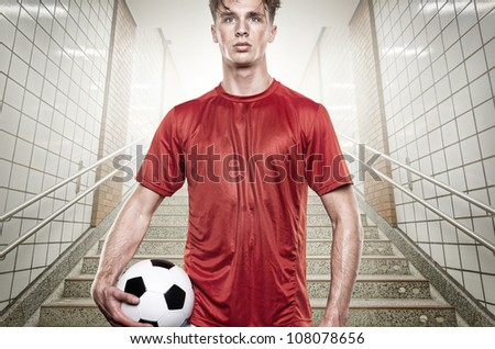 Young soccer player in gray tunnel
