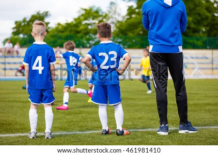 young soccer players with...