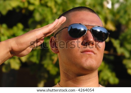 Young soldier giving salute during basic training