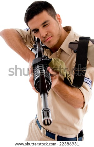 young soldier going to shoot with gun on an isolated background