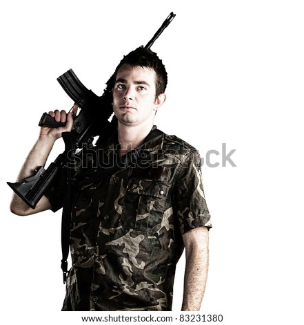 young soldier holding a rifle on a white background
