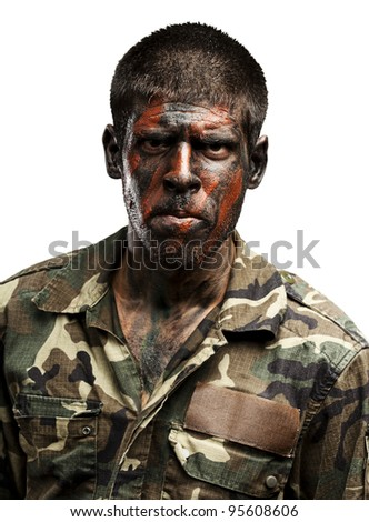 young soldier with camouflage paint looking very serious over white