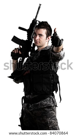 young soldier with urban camouflage on a white background